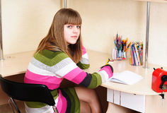 Teen girl doing homework Stock Photos