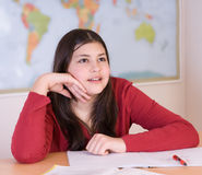 Teen girl doing homework Royalty Free Stock Image