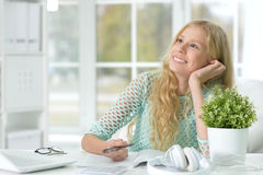 Teen girl doing lessons. Portrait of a teen girl doing lessons at home Stock Photo