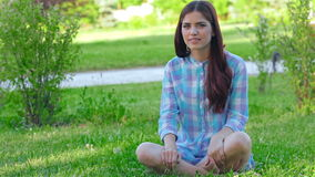 Teen girl doing yoga in the park stock video footage