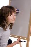 Teen girl draws Stock Photos