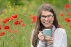 Teen girl drink cup of tea Royalty Free Stock Photography