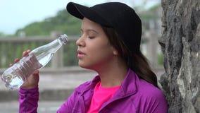 Teen Girl Drinking Bottled Water stock video