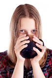 Teen girl drinking from mug Stock Image