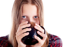 Teen girl drinking from mug Stock Photography