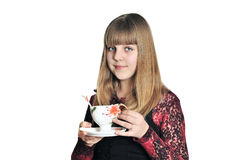 Teen girl drinking a tea Stock Photography