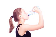 Teen girl drinking water from bottle Stock Photography