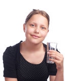 Teen girl drinking water from glass Stock Photography