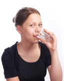Teen girl drinking water from glass Stock Images