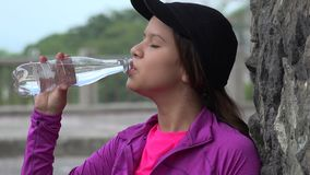 Teen Girl Drinking Water Royalty Free Stock Photos