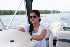 Teen Girl Driving a Boat Stock Photos