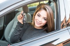 Teen Girl Driving Car. Happy teen girl driving a new car Stock Images