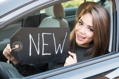 Teen Girl Driving Car. Happy teen girl driving a new car Royalty Free Stock Photos