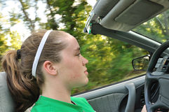 Teen Girl Driving a Convertible Car. Horizontal, Copy Space Stock Images
