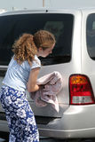 Teen Girl Drying Car Stock Photography