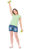 Teen girl with dumbbells Royalty Free Stock Images