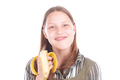 Teen girl eating banana Royalty Free Stock Photo