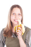 Teen girl eating banana Royalty Free Stock Photos