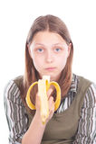 Teen girl eating banana Stock Photos