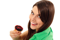 Teen girl eating berry cake isolated on white. Background royalty free stock photo
