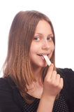 Teen girl eating bubblegum on white background Stock Images