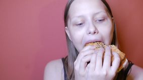 Teen girl eating a burger stock video footage