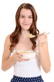 Teen girl eating cereal Royalty Free Stock Photo