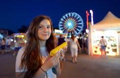 Teen girl eating corn Royalty Free Stock Photo