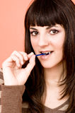 Teen Girl Eating A Lollipop Royalty Free Stock Images