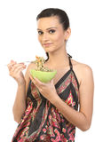 Teen girl Eating Noodles. Image of a Teen girl Eating Noodles in the green bowl Royalty Free Stock Photography
