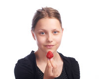 Teen girl eating strawberry Royalty Free Stock Photos