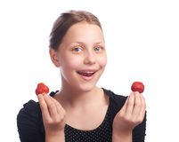 Teen girl eating strawberry Royalty Free Stock Photo