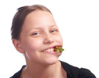 Teen girl eating strawberry Royalty Free Stock Images