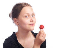 Teen girl eating strawberry Stock Photography