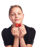 Teen girl eating strawberry Stock Image