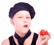 Teen girl eating tomato Stock Photos
