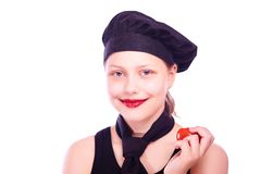 Teen girl eating tomato Stock Image