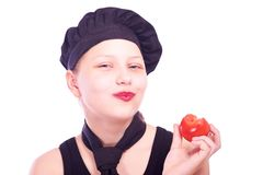 Teen girl eating tomato Stock Images
