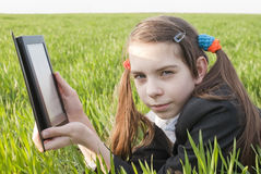 Teen girl with electronic book Royalty Free Stock Photography