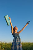 Teen girl with electronic book reader Royalty Free Stock Photo