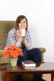 Teen girl enjoying a coffee Royalty Free Stock Photo