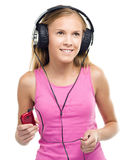 Teen girl enjoying music using headphones Royalty Free Stock Photos