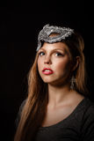 Teen girl with an evening make-up and masquerade mask. Stock Photo