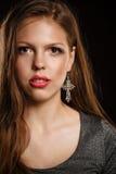 Teen girl with an evening makeup looking at camera Stock Photo