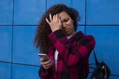 Teen girl excessively sitting at the phone at home. he is a victim of online bullying Stalker social networks. Teen girl excessively sitting at the phone at home Royalty Free Stock Photography