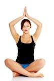 Teen girl exercising yoga Stock Photo