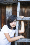 Teen girl with expressive eyes, a portrait in the countryside. Emo. Black-haired teen girl with expressive eyes, a portrait in the countryside. Emo Royalty Free Stock Photography