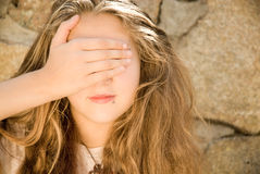 Teen Girl Eyes Shut. Close up of teen girl covering her eyes with her hand Stock Photography