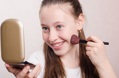 Teen girl face powders Royalty Free Stock Images
