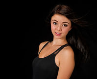 Teen girl fading into the black shadows Stock Image